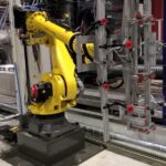 Fanuc 6 Axis Robot with 5 insert loading head and demould