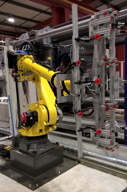 Fanuc 6 Axis with 5 insert loading head and demould